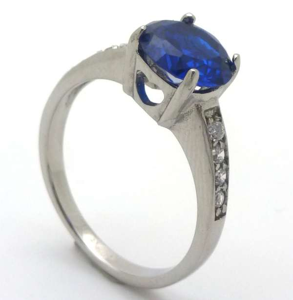 Joyas de acero quirurgico por mayor, anillos. Solitario con circón central azul redondo de 8 mm y 4-Joyas de Acero-Anillos-RA0670